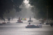 Rescue workers transport residents trapped by rising water from Hurricane Isaac in the River Forest subdivision on August 29 2012 in LaPlace...
