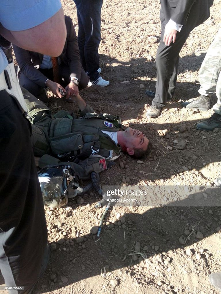 Rescue workers treat injured pilots who jumped out of the military plane with parachutes on September 30, 2013 in Sivas, Kangal. A Turkish military plane has crashed near Kangal district of Turkey's central city of Sivas and the two pilots parachuted down with injuries.