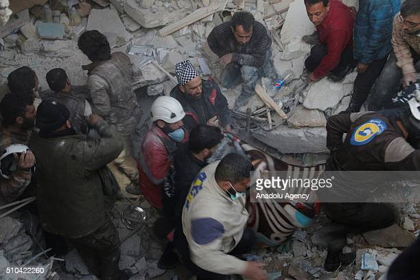 Rescue workers try to pull victims from the debris of a collapsed hospital belongs to humanitarian aid organization 'Doctors Without Borders' after...