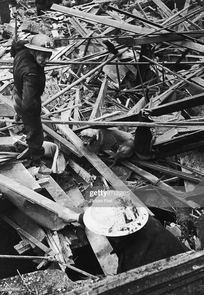 Rescue workers use a sniffer dog to search for casualties in the ruins of Farringdon Market, London, after a V-2 rocket attack, which killed over 300 people, 8th March 1945. Original Publication : Picture Post - 1967 - One Story We Couldn't Tell - pub. 2 October 1948