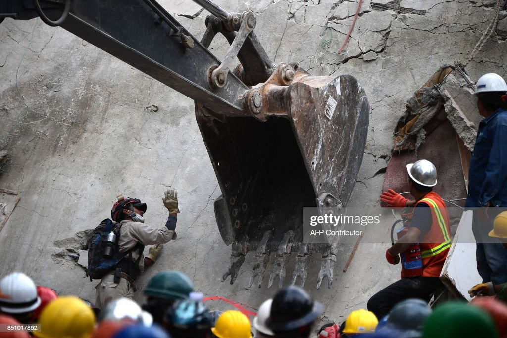 Rescue workers use heavy machinery in the search for survivors in Mexico City on September 21, 2017, two days after a strong quake hit central Mexico. A powerful 7.1 earthquake shook Mexico City on Tuesday, causing panic among the megalopolis' 20 million inhabitants on the 32nd anniversary of a devastating 1985 quake. /