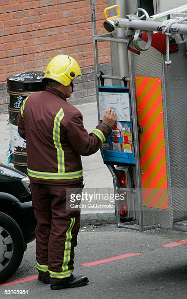 A rescue workers waits next to a fire engine in Shoreditch High Street in Bethnal Green on July 21 2005 in London England The windows were blown out...