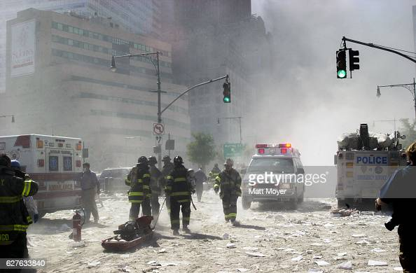 Rescue workers walk amongst the debris at ground zero after the attack on the World Trade Center on Sept 11 2001