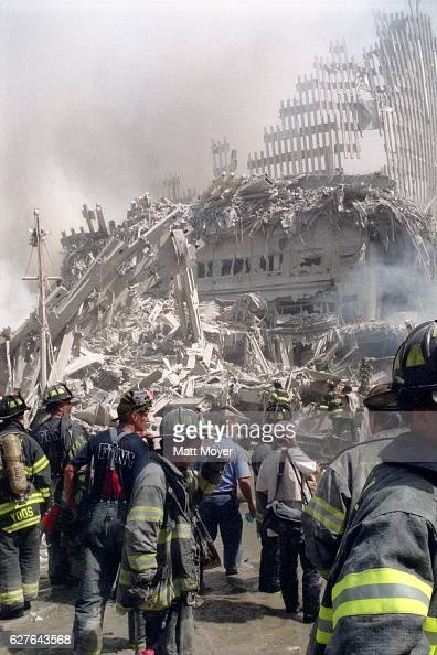 Rescue workers walk amongst the debris while searching for survivors after the attack on the World Trade Center on Sept 11 2001
