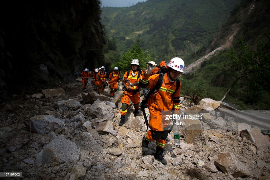 Rescue workers walk to BaoXing county, one of the hardest hit areas of the earthquake zone, on April 21, 2013 in China. A powerful earthquake struck the steep hills of China's southwestern Sichuan province on the morning of April 20, leaving hundreds dead and thousands injured.