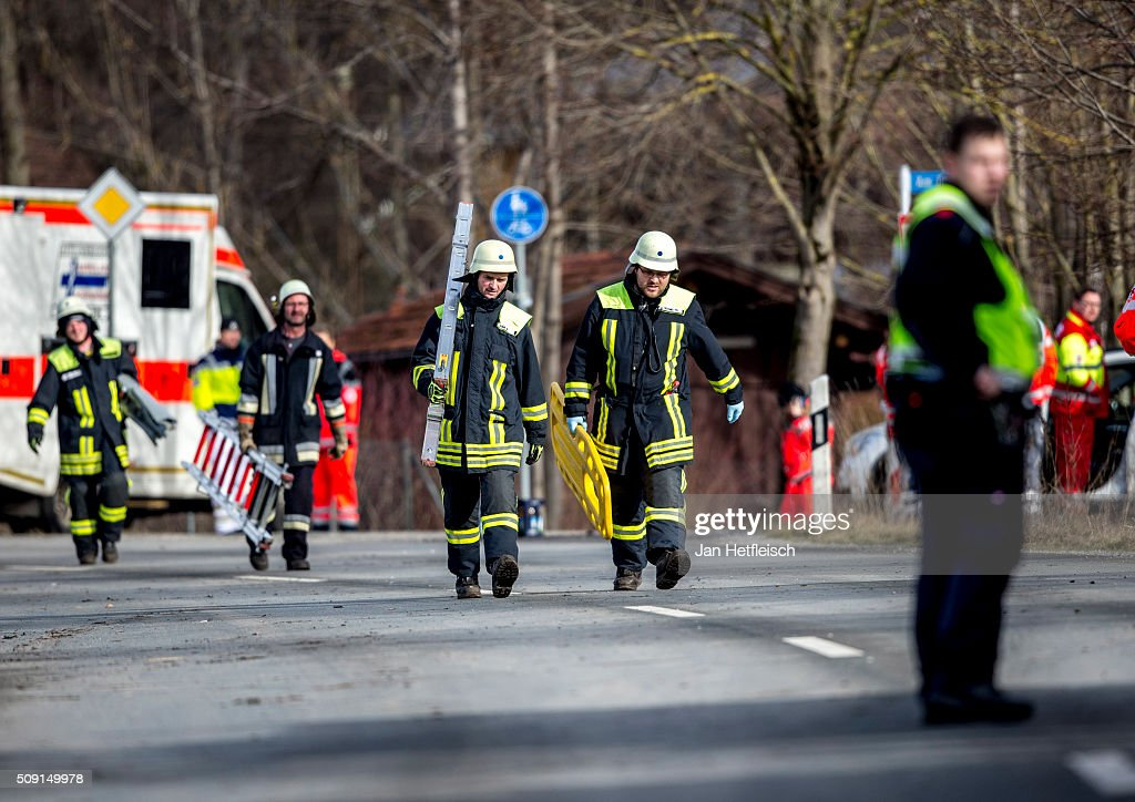 Rescue workers walk to the wreckage of two trains that collided head-on several hours before in Bavaria on February 9, 2016 near Bad Aibling, Germany. Authorities say at least nine people are dead and over 100 injured in the collision between two trains of the Meridian local commuter train service that occurred at approximately 7 am.