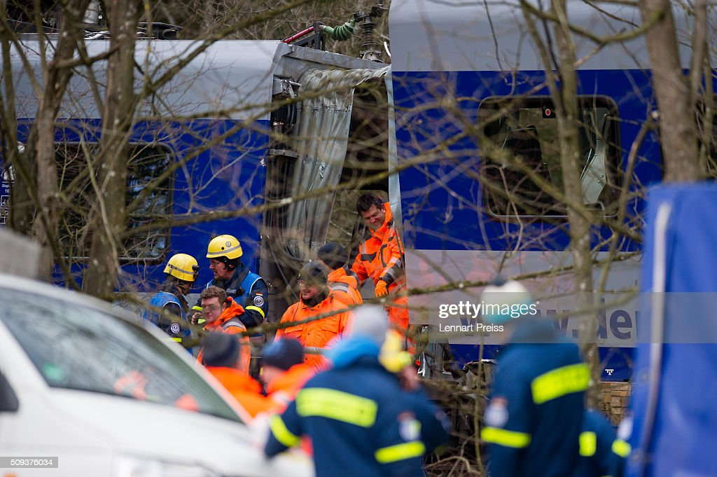 Rescue workers work at the wreckage of two trains that collided head-on the day before in Bavaria on February 10, 2016 near Bad Aibling, Germany. Authorities say at least nine people are dead and over 100 injured in the collision between two trains of the Meridian local commuter train service that occurred at approximately 7:00 am yesterday.