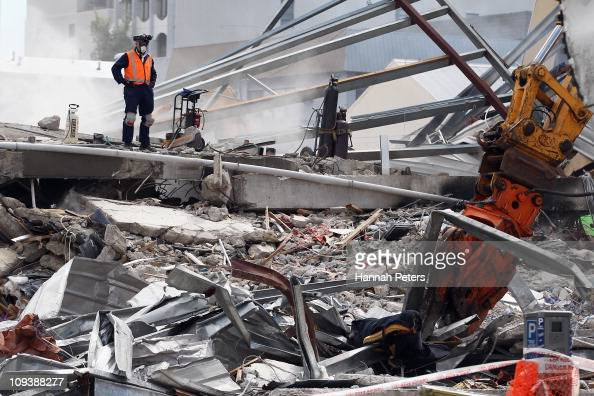Rescue workers work on the remains of the CTV building on February 24 2011 in Christchurch New Zealand A massive search and rescue mission is...