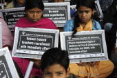 Rescued child labourers hold placards and shout slogans during a protest in New Delhi on February 17 2010 Hundreds of rescued labourers participated...