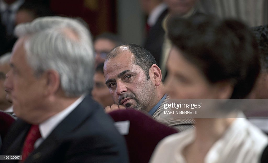 Rescued miner Mario Sepulveda is seen between Chilean President Sebastian Pinera and French actress Juliette Binoche at La Moneda presidential palace...