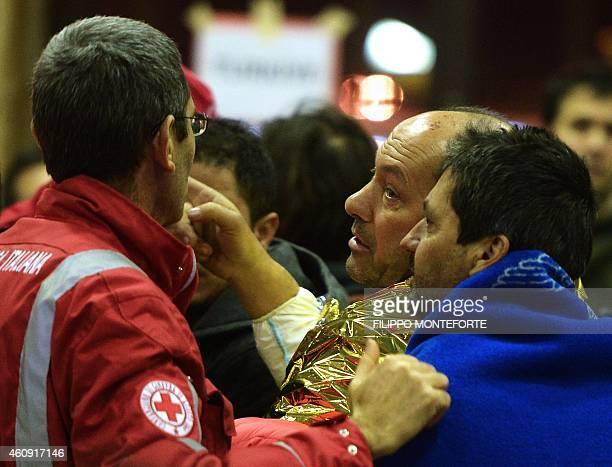 A rescued passenger of the 'Norman Atlantic' ferry gestures on December 30 2014 to an Italian Red Cross worker after the arrival in Brindisi southern...