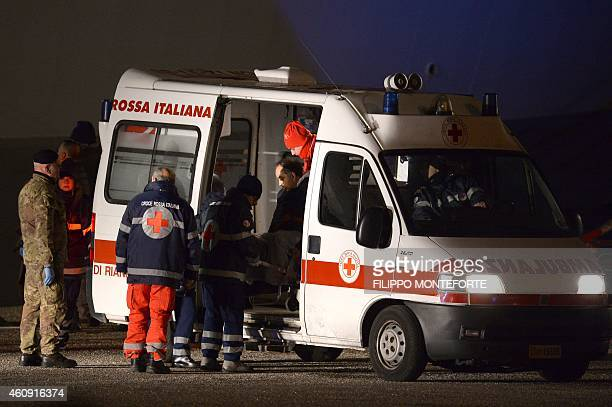 A rescued passenger of the Norman Atlantic ferry is taken in an ambulance as he arrives in Brindisi southern Italy with the italian Navy San Giorgio...