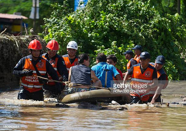 Rescued people are taken to safety by Mexican Federal Police officers on an inflatable dinghy in a flooded street of Acapulco state of Guerrero...