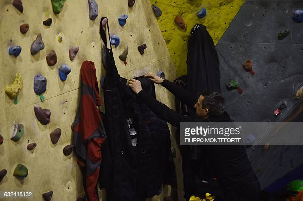 A rescuer hangs his clothes as he arrives to rest at the rescue operations center in Penne some 20 km from the site of an avalanche that engulfed the...