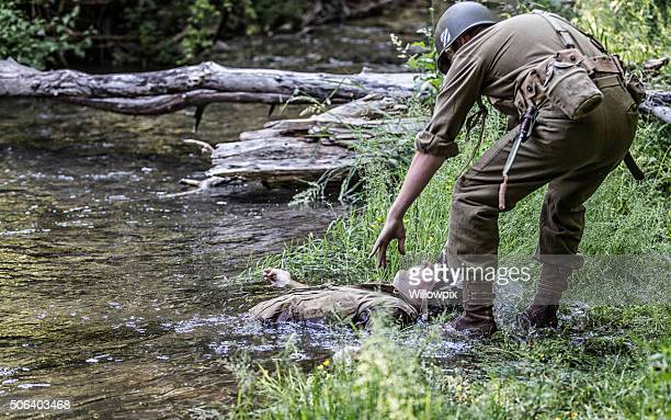 Rescuer Reaching For Wounded WWII US Army Combat Casualty Soldier