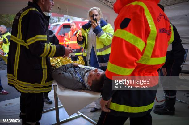 Rescuers and Firefighters take care of the victims at the Advanced Medical Post during an exercise simulating a terrorist attack inside the theatre...