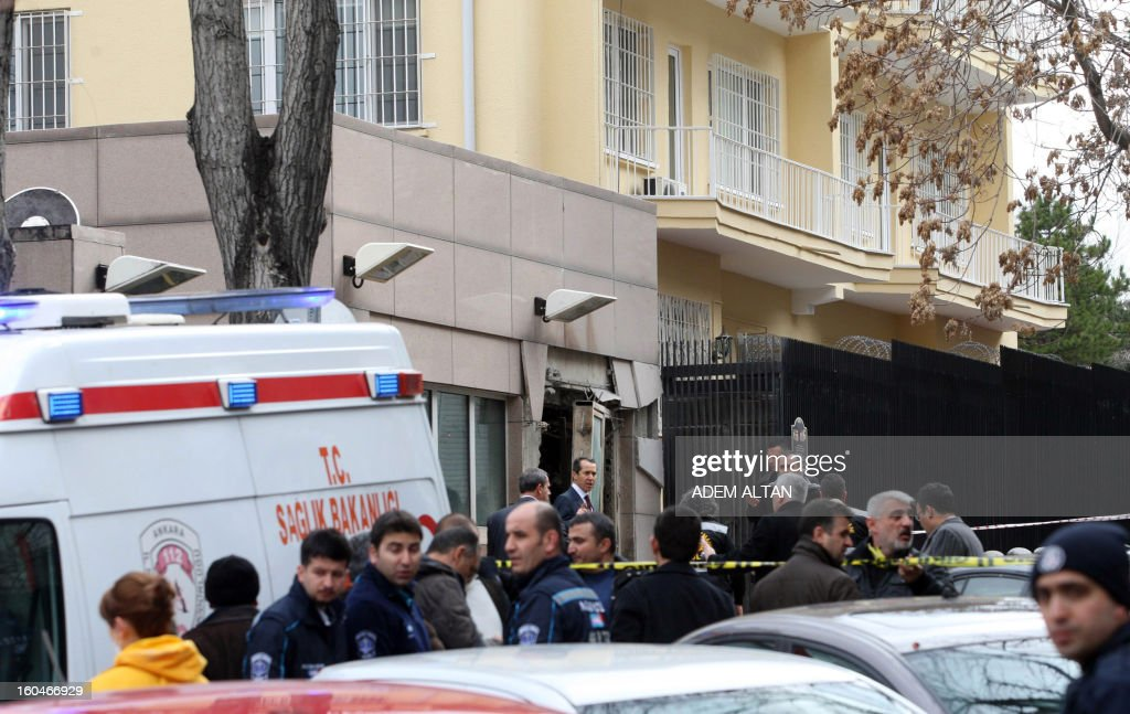Rescuers and forensic experts work on February 1, 2013 at the site of a blast outside the US Embassy in Ankara. Two security guards were killed in the blast outside the US embassy, local television reported, amid speculation it was a suicide attack. The force of the explosion damaged nearby buildings in the Cankaya neighborhood where many other state institutions and embassies are also located. AFP PHOTO / ADEM ALTAN