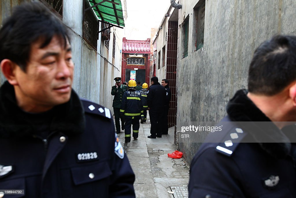 Rescuers and inspectors checks a private orphanage after a fire swept through the home for orphans and abandoned children in Lankao, in central China's Henan province on January 4, 2013. Seven children died and another was injured in the accident, local government and state media said. CHINA