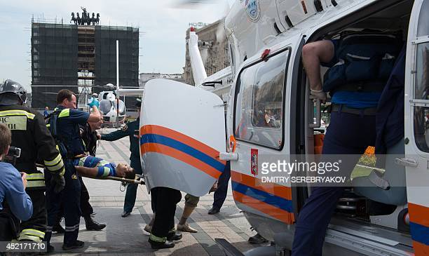 Rescuers and paramedics use helicopters to evacuate passengers injured as several subway cars derailed in Moscow on July 15 2014 Three people died...