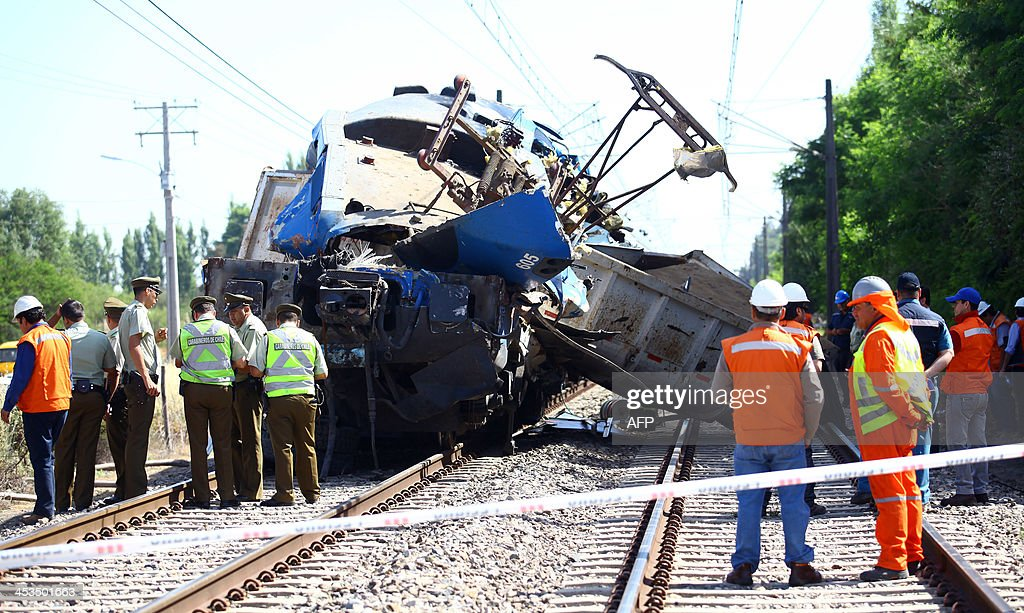 Rescuers and police work on the wreckage of a passenger train that collided with a truck near Requinoa some 100km south of Santiago on December 4...