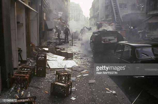 Rescuers and policemen on the site where a car bomb exploded in front of a proIraqi newspaper on the Rue Marbeuf near Champs Elysees on April 22 1982...