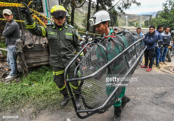 Rescuers arrive to help in the search operations a day after an explosion at the El Cerezo illegal coal mine killed at least eight people in the...