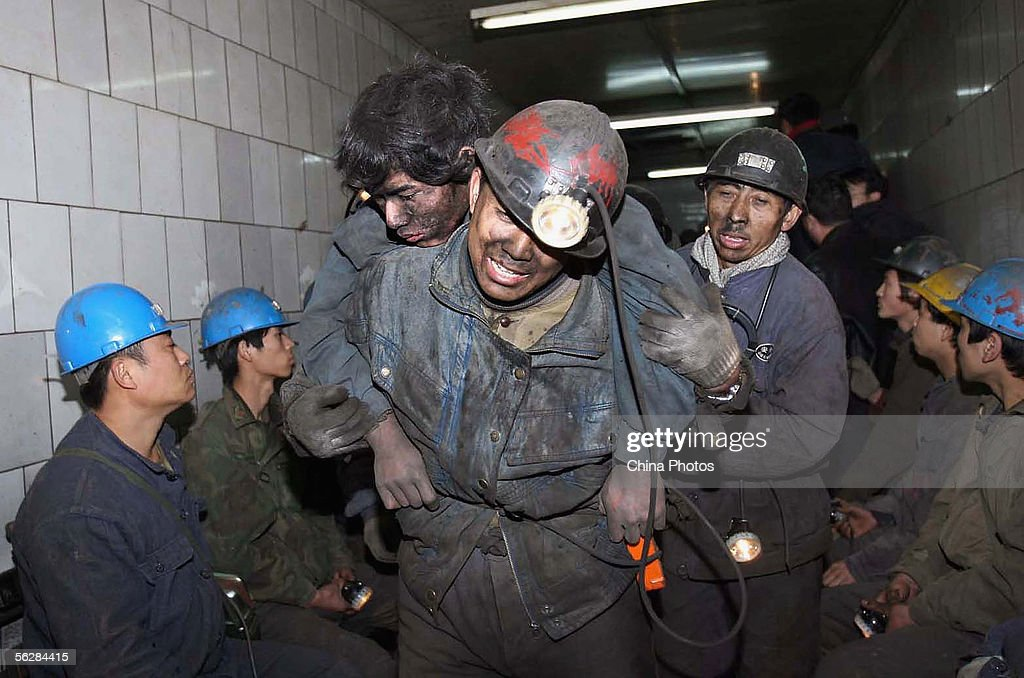 Rescuers assist miner Feng Yin after he was trapped following a blast accident that occured at Dongfeng Coal Mine on November 28, 2005 in suburb of Qitaihe City of Heilongjiang Province, northeast China. Altogether 221 miners were working underground when the blast went off. 134 miners are claimed to of been killed, 15 missing, and 72 surviving, according to reports.