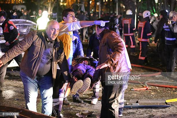 Rescuers carry a victim on a stretcher at the scene of a blast in Ankara on March 13 2016 At least 27 people were killed and 75 others wounded in a...