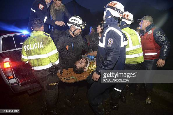 TOPSHOT Rescuers carry one of the survivors from the LAMIA airlines charter plane carrying members of the Chapecoense Real football team that crashed...