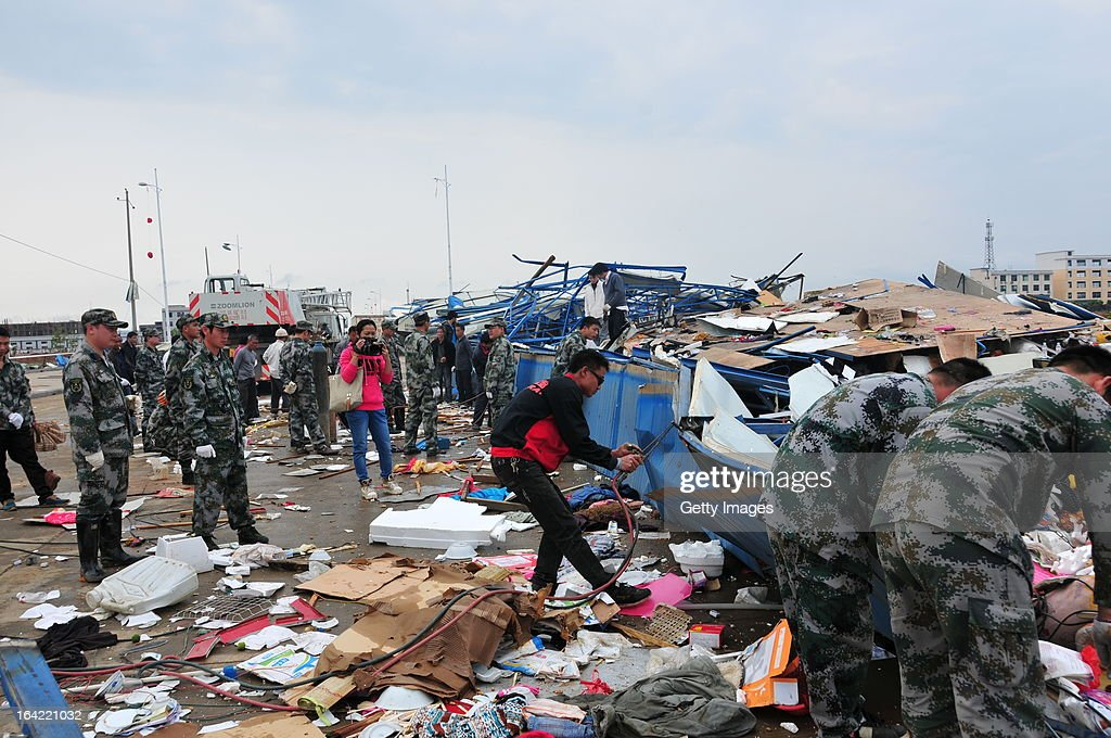 Rescuers clean remains of a collapsed shed on March 20, 2013 in Daoxian, China. Three people have been killed and about 50 others injured after a tornado struck Central China's Hunan Province early on Wednesday morning.