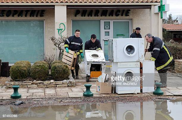 Rescuers collect damaged washing machines as they clean a street on March 3 in Charron western France after a storm dubbed 'Xynthia' which killed 52...