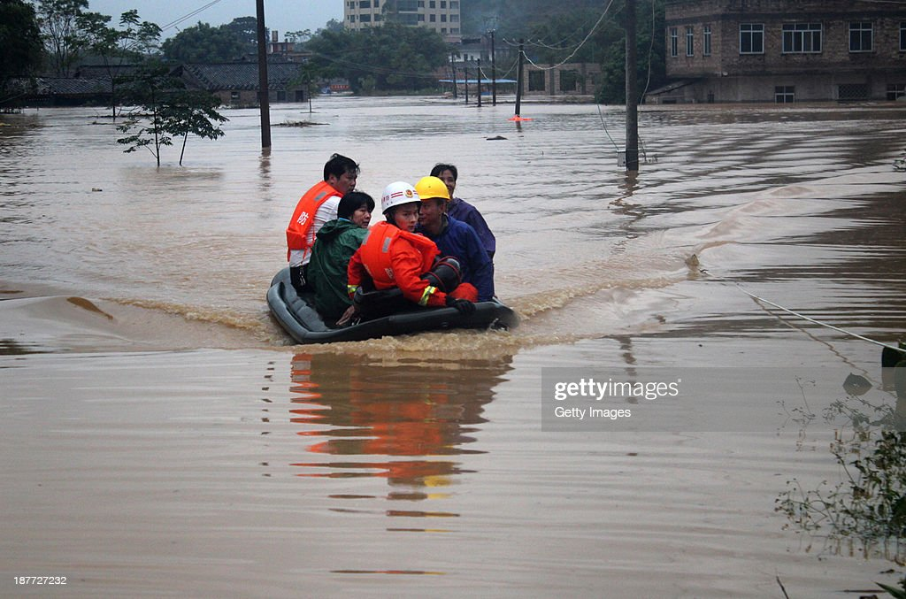 Rescuers evacuate residents from flood-hit areas on November 11, 2013 in Bobai County, China. Typhoon Haiyan, which left a trail of destruction in the Philippines, weakened into a tropical depression and brought gales and rainstorms to South China on Sunday.