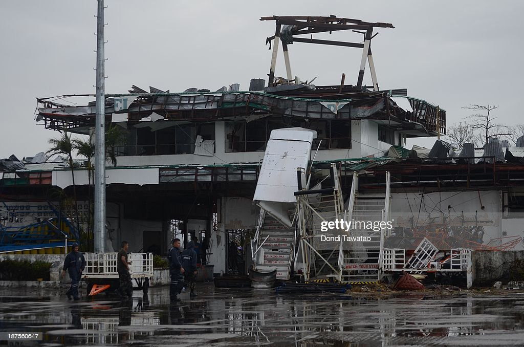 Rescuers inspect the heavily damaged airport in the aftermath of typhoon Haiyan on November 10, 2013 in Tacloban City, Leyte, Philippines. Typhoon Haiyan, packing maximum sustained winds of 195 mph (315 kph), slammed into the southern Philippines and left a trail of destruction in multiple provinces, forcing hundreds of thousands to evacuate and making travel by air and land to hard-hit provinces difficult. Around 10,000 people are feared dead in the strongest typhoon to hit the Philippines this year.