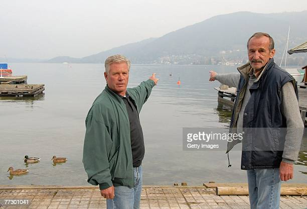 Rescuers KarlHeinz Barth and Franz Payr point out to lake Tegernsee where they saved two cast members after a canoe carrying three people capsized...
