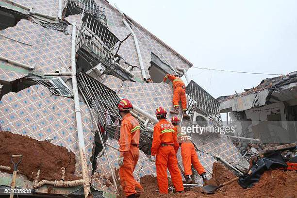 Rescuers look for survivors after a landslide hit an industrial park in Shenzhen south China's Guangdong province on December 20 2015 A landslide at...