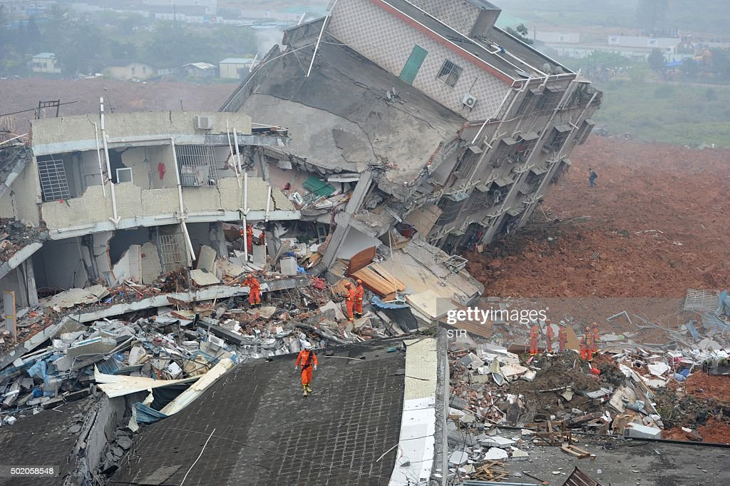 TOPSHOT Rescuers look for survivors after a landslide hit an industrial park in Shenzhen south China's Guangdong province on December 20 2015 A...