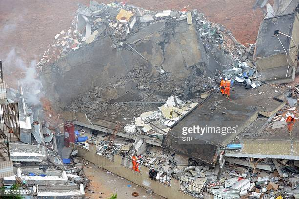 Rescuers look for survivors after a landslide hit an industrial park in Shenzhen south China's Guangdong province on December 20 2015 A massive...