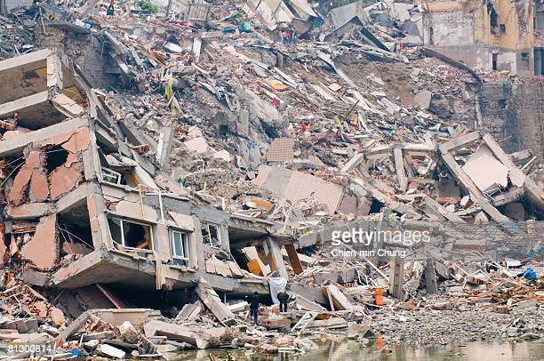 Rescuers look for survivors May 16 2008 in Beichuan China 50000 people are estimated to have been killed in the deadliest earthquake in China in a...