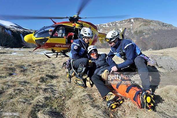 Rescuers of the gendarmerie mountain squad of Murat take part in an exercice on February 11 2011 in Lavignerie central France At background is a...