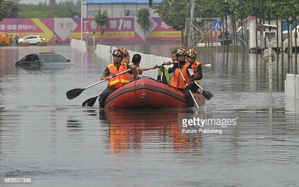 Rescuers on work in a flooded area on July 25 2016 in Shenyang China Downpours hit the city again Tuesday flooding many areas in the city Feature...