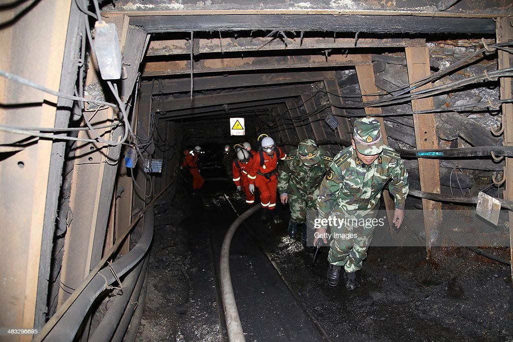 Rescuers race against time to pump water from a flooded coal mine where 22 miners were trapped underground on April 7 2014 in Qujing Yunnan Province...