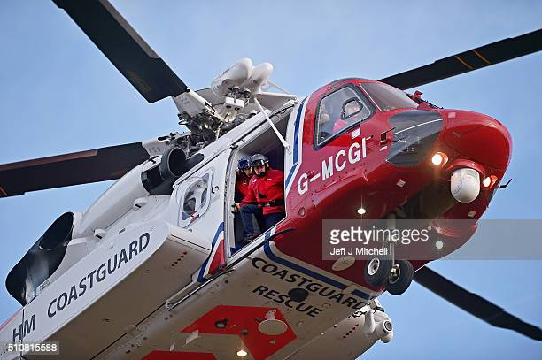 Rescuers resume a search with help from a Coastguard helicopter for two experienced climbers missing on Ben Nevis on February 17 2016 in Fort...