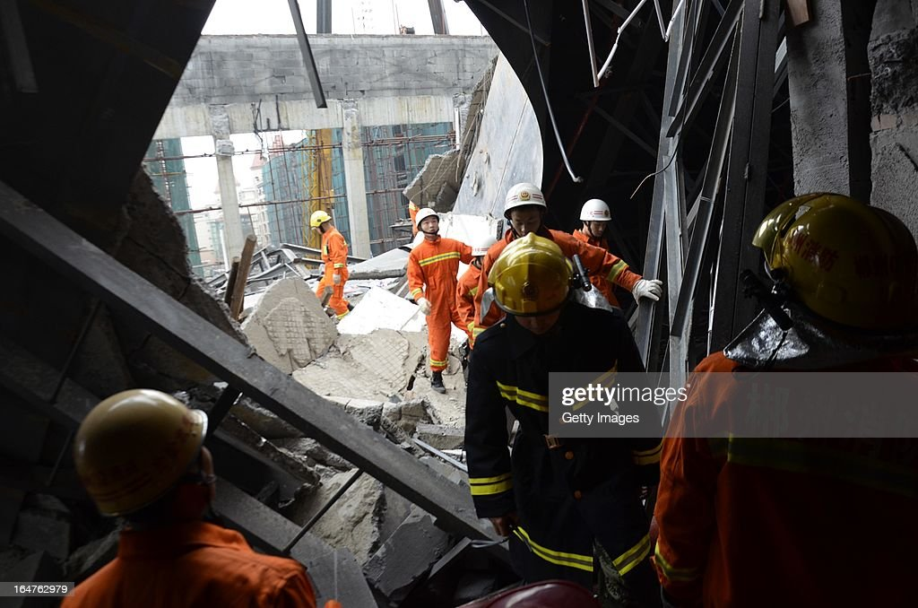 Rescuers search for buried workers on March 27, 2013 in Zixing, China. Two workers were killed and four injured after a wall collapsed in a hotel that was under construction in Zixing city of Hunan province on Wednesday morning.