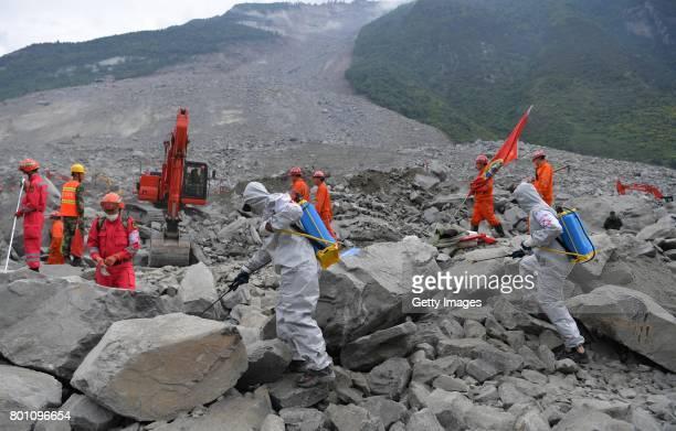 Rescuers search for survivors at the accident site after a landslide at Xinmo village on June 26 2017 in Maoxian County China The landslide occurred...