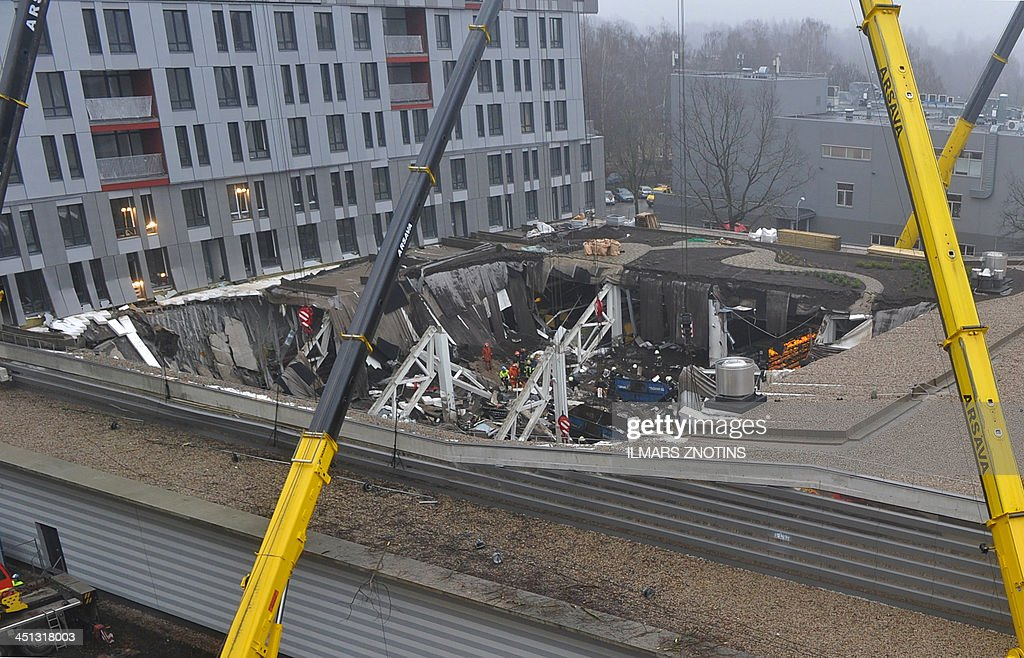 Rescuers search for survivors at the scene where the Maxima supermarket roof collapsed in Riga on November 22, 2013. Thirty three were killed and around 40 others injured when the roof of a supermarket collapsed a day earlier in a suburb of Latvia's capital Riga, emergency services said.