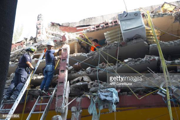 TOPSHOT Rescuers search for survivors buried under the rubble and debris of a building flattened by a 71magnitude quake in Mexico City on September...