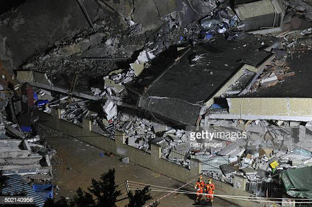 Rescuers search for survivors in the rubble of collapsed buildings on December 20 2015 in Shenzhen China Three people were injured and at least 91...