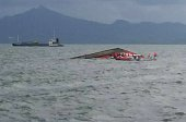 Rescuers search for survivors next to the capsized passenger ferry off Ormoc City central Philippines on July 2 2015 At least 36 people were killed...