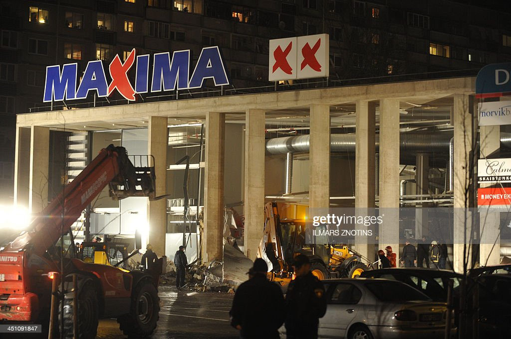 Rescuers search for survivors on November 21, 2013 at the Maxima supermarket in Riga, after a roof collapsed. Four people were killed and around 30 others injured on Thursday when the roof of a supermarket collapsed in a suburb of Latvia's capital Riga, emergency services said. AFP PHOTO/ Four people were killed and around 30 others injured on Thursday when the roof of a supermarket collapsed in a suburb of Latvia's capital Riga, emergency services said.