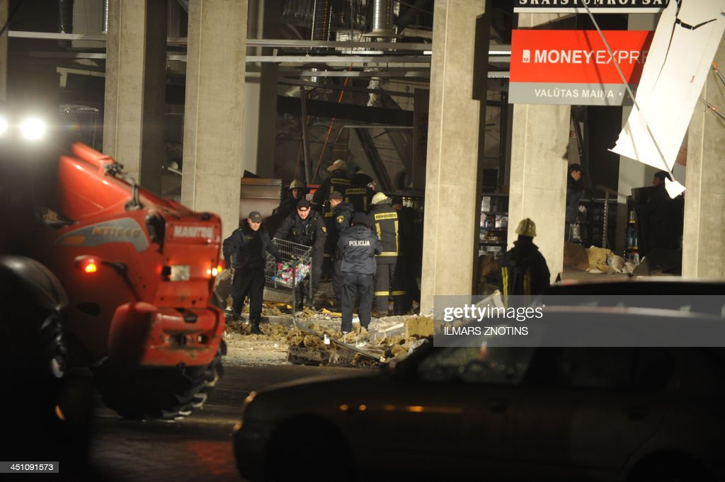 Rescuers search for survivors on November 21, 2013 under the rubble at the Maxima supermarket in Riga, after a roof collapsed. Four people were killed and around 30 others injured on Thursday when the roof of a supermarket collapsed in a suburb of Latvia's capital Riga, emergency services said. AFP PHOTO/ Four people were killed and around 30 others injured on Thursday when the roof of a supermarket collapsed in a suburb of Latvia's capital Riga, emergency services said.